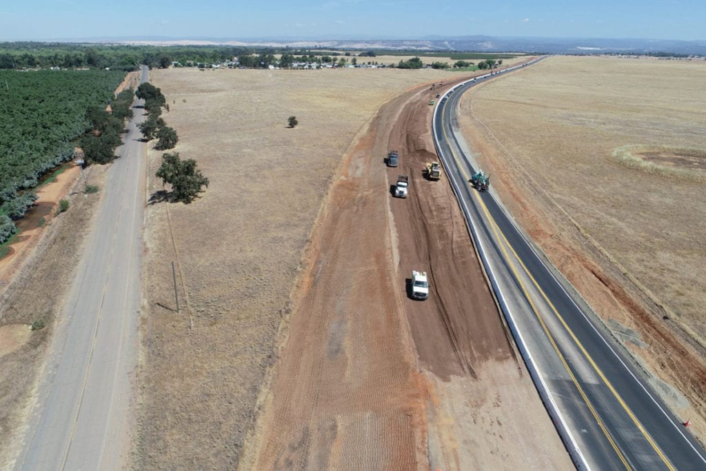Photo of trucks working on the Highway 70 expansion project